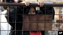 A relative of an inmate awaits news outside the Litoral Penitentiary in Guayaquil, Ecuador, Wednesday, September 29, 2021. (AP Photo/Angel DeJesus)