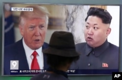 FILE - A man watches a television screen showing President Donald Trump and North Korean leader Kim Jong Un during a news program at the Seoul Train Station in Seoul, South Korea, Aug. 10, 2017.