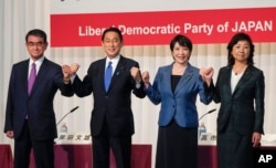 Candidates for the presidential election of the ruling Liberal Democratic Party pose prior to a joint news conference at the party's headquarters in Tokyo, Japan, Sept. 17, 2021. The candidates are, from left, Taro Kono, Fumio Kishida, Sanae Takaichi and Seiko Noda.