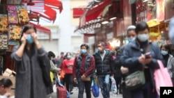 People wear masks at a market in Hong Kong, Feb, 3, 2020.