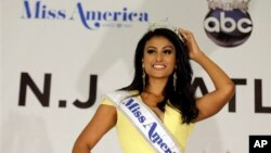 Miss New York Nina Davuluri poses for photographers following her crowning as Miss America 2014, Sunday, Sept. 15, 2013, in Atlantic City, N.J. (AP Photo/Mel Evans)