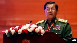 Myanmar's Army Commander Senior Gen. Min Aung Hlaing speaks at the Myanmar International Convention Center in Naypyitaw, Feb. 13, 2018.