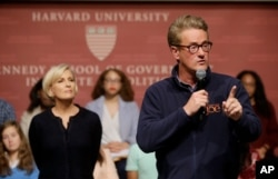 """FILE - MSNBC television anchors Joe Scarborough, right, and Mika Brzezinski, co-hosts of the show """"Morning Joe,"""" take questions at a discussion forum on the campus of Harvard University, in Cambridge, Massachusetts, Oct. 11, 2017."""