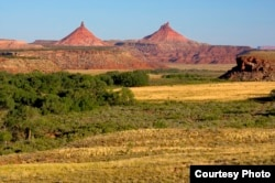 Seen in the distance are the twin buttes which gave the Bears Ears area its name. Courtesy, Department of the Interior