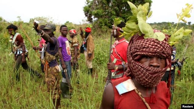 Members of the anti-balaka, a Christian militia, patrol outside the village of Zawa, Central African Republic, April 8, 2014.