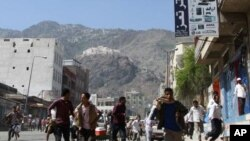 Masu zanga zangar a birnin Taiz kasar Yamal.