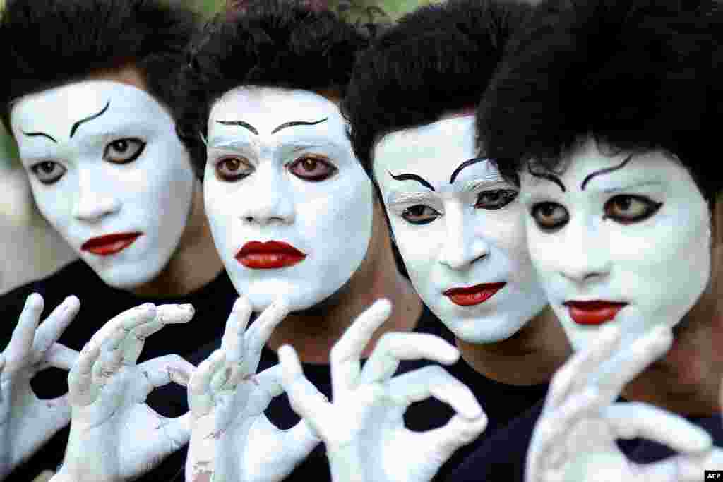 Indian students wait their turn to perform a mime act during a Youth Festival competition at a university in Amritsar.