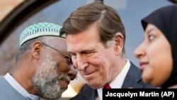 FILE - U.S. Rep. Don Beyer, center, meets with imam Johari Abdul-Malik, left, and others at Dar al-Hijrah Mosque in Falls Church, Va., Dec. 4, 2015. The Virginia Democrat is pressing Cairo to release Egyptian-American Aya Hijazi.