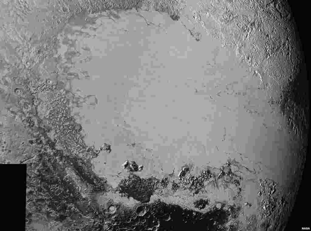 Mosaic of high-resolution images of Pluto, sent back from NASA's New Horizons spacecraft from Sept. 5 to 7, 2015. The image is dominated by the informally-named icy plain Sputnik Planum, the smooth, bright region across the center. This image also features a tremendous variety of other landscapes surrounding Sputnik.