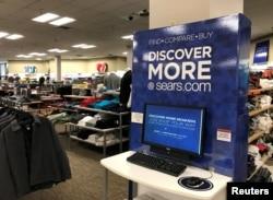 FILE - An online shopping kiosk is shown inside a Sears department store in La Jolla, California, March 22, 2017.