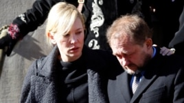Actress Cate Blanchett and her husband Andrew Upton leave the funeral of actor Philip Seymour Hoffman, Feb. 7, 2014, in New York.