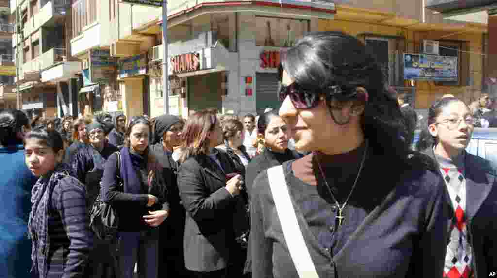 A young Christian woman waits in line to enter the cathedral. (VOA-E. Arrott)