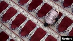 FILE - A man prays at the Cut Meutia Mosque in Jakarta, Indonesia.