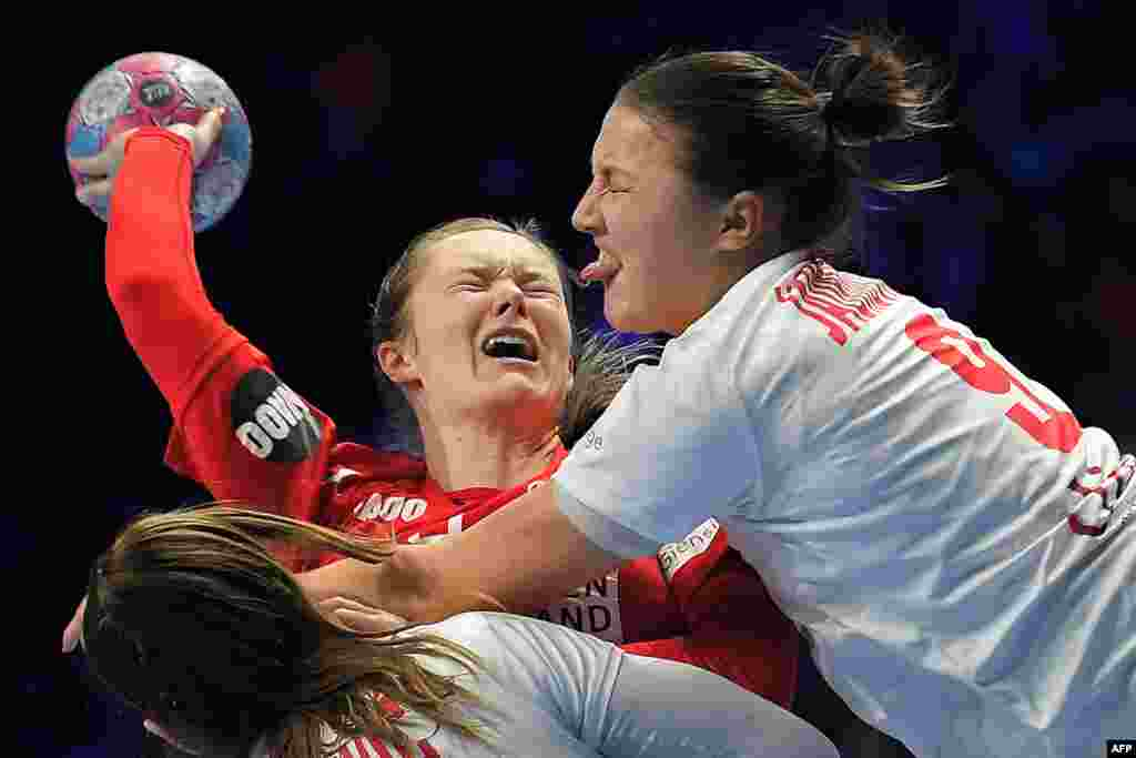 Denmark's left back Anne Mette Hansen (C) plays with Montenegro's left back Durdina Jaukovic during the Euro 2018 European Women's Handball Championship Group 1 main round match between Denmark and Montenegro at the XXL hall in Nantes, France.