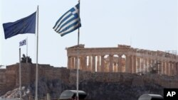 Greece reached an agreement with Europe on its debt. But debt campaigners say many developing countries are falling into a debt trap. (AP Photo/Thanassis Stavrakis)