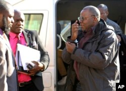 FILE: Zimbabwean opposition official Tendai Biti arrives at the magistrates courts in Harare, Thursday Aug. 9, 2018. Biti was deported to Zimbabwe following his arrest in Zambia after his asylum bid was rejected.
