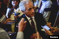 FILE - Senator Bob Corker speaks to reports at the US Capitol in Washington, April 21, 2015.