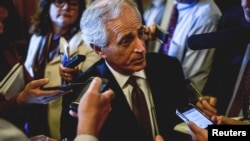 FILE: Senator Bob Corker speaks to reporters at the US Capitol in Washington, April 21, 2015.