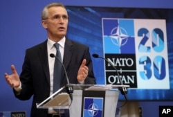NATO Secretary General Jens Stoltenberg speaks during a media conference ahead of a NATO defense minister's meeting at NATO headquarters in Brussels, Feb. 15, 2021.