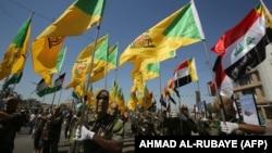 رژه اعضای حزبالله عراق در بغداد در روز قدس