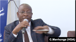 Ziyambi Ziyambi, Zimbabwe's justice minister, speaks at a public meeting in Chinhoyi town, May 10, 2019.