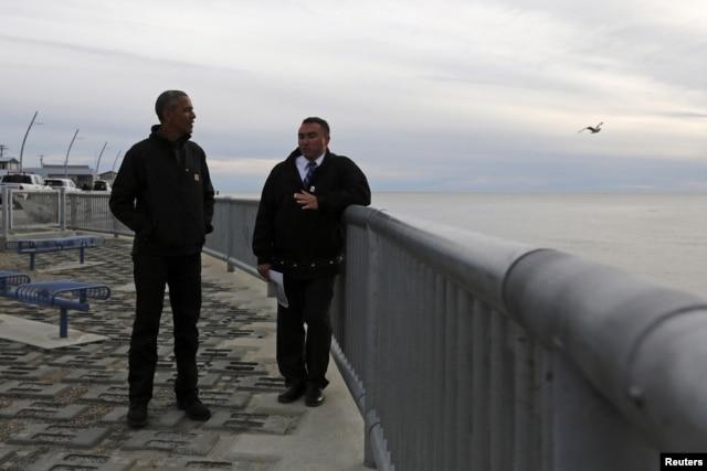U.S. President Barack Obama (L) tours the Kotzebue Shore Avenue Project, an effort to protect against rising sea levels in Kotzebue, Alaska Sept. 2, 2015.