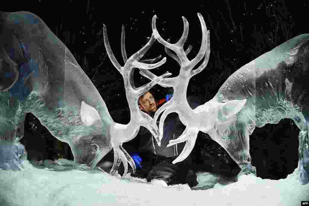 "Ice sculptor Darren Jackson finishes an ice sculpture of two stags, which makes up part of a forthcoming exhibition, ""The Ice Adventure: A Journey Through Frozen Scotland,"" in Edinburgh, Scotland, Nov. 14, 2017."