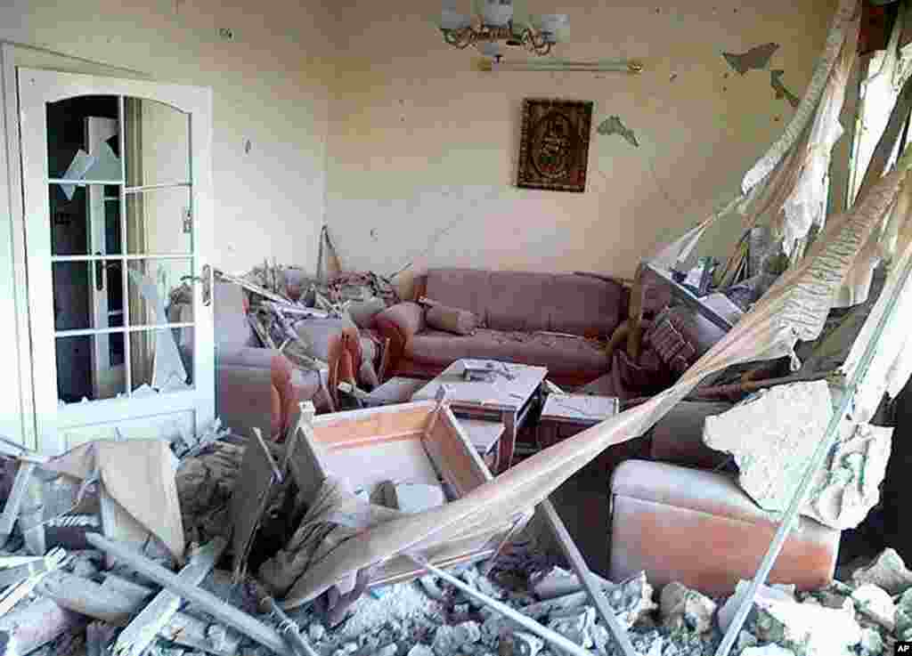 A home damaged by Syrian government forces shelling, in the Baba Amr neighborhood in Homs province, February 20, 2012 (AP/Local Coordination Committees in Syria)