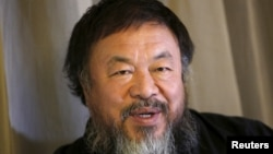 FILE - Dissident Chinese artist Ai Weiwei speaks during an interview with Reuters at his hotel in Beijing, March 24, 2015