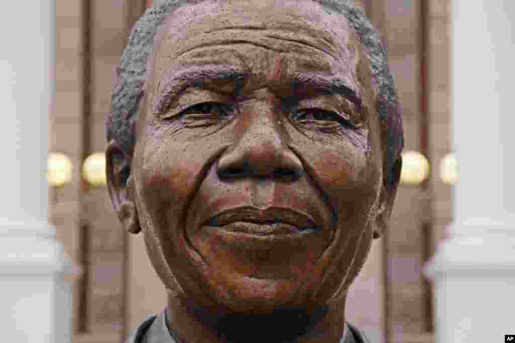Raindrops fall on the statue of former South African President Nelson Mandela outside parliament in Cape Town, South Africa, Friday, July 18, 2014.