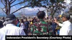 President Joko Widodo visits Talise Beach, Palu, where the tsunami hit after the earthquake, on September 30, 2018.