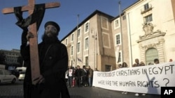 Coptic Christians gather in Rome, to demand religious freedom and protection following a church attack in Egypt that killed 21 worshipers.