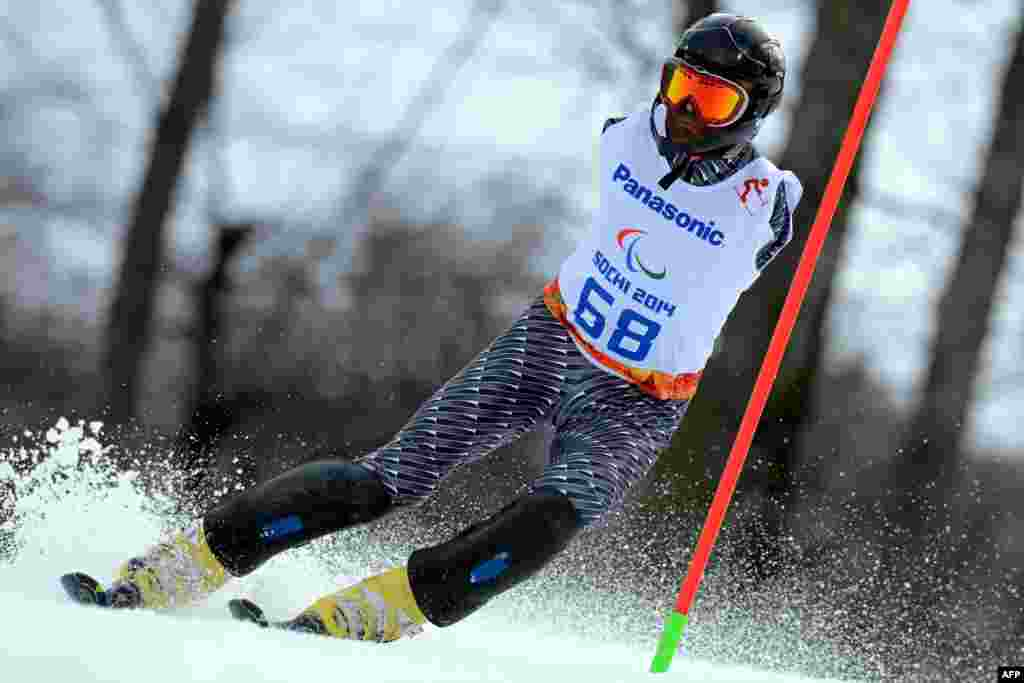 Armenia's Mher Avanesyan (LW 5/7-1) competes in the Men's Alpine Skiing Slalom Standing during the XI Paralympic Olympic Games at the Rosa Khutor Alpine Center near Sochi, Russia.