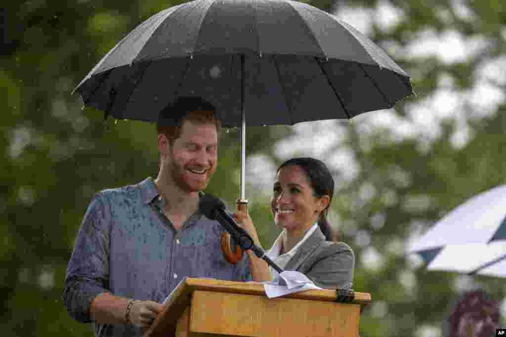 Britain's Prince Harry and Meghan, Duchess of Sussex attend a community picnic at Victoria Park in Dubbo, Australia.