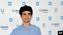 "In this April 25, 2019, file photo, Cameron Boyce arrives at WE Day California at The Forum in Inglewood, Calif. Boyce was known for his roles in the Disney Channel franchise ""Descendants"" and the Adam Sandler film ""Grown Ups."" (Richard Shotwell/AP)"