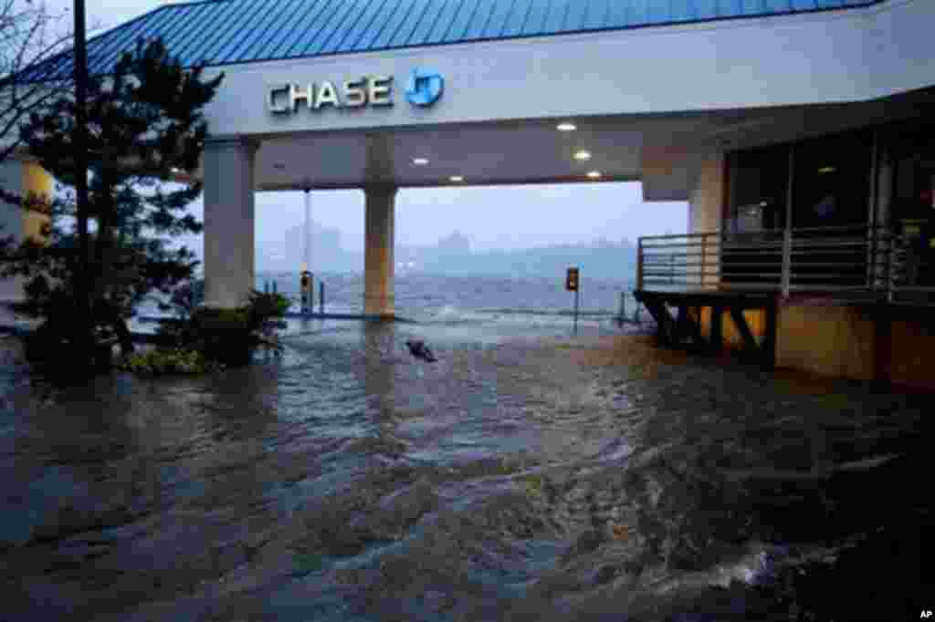 Rising water from the Hudson River overtakes a bank drive-through in Edgewater, New Jersey, October 29, 2012, as Hurricane Sandy lashed the East Coast.