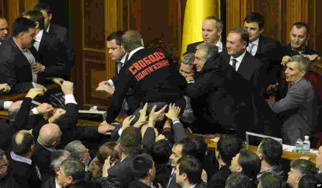 Lawmakers fight in parliament, Kyiv, Ukraine, December 12, 2012.