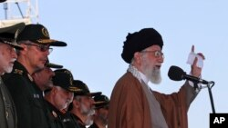 In this picture released by official website of the office of the Iranian supreme leader, May 10, 2017, Supreme Leader Ayatollah Ali Khamenei speaks during a graduation ceremony of a group of the Revolutionary Guard cadets in Tehran, Iran.
