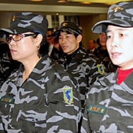 Members of the North Korea Peoples Liberation Front at a briefing in Seoul