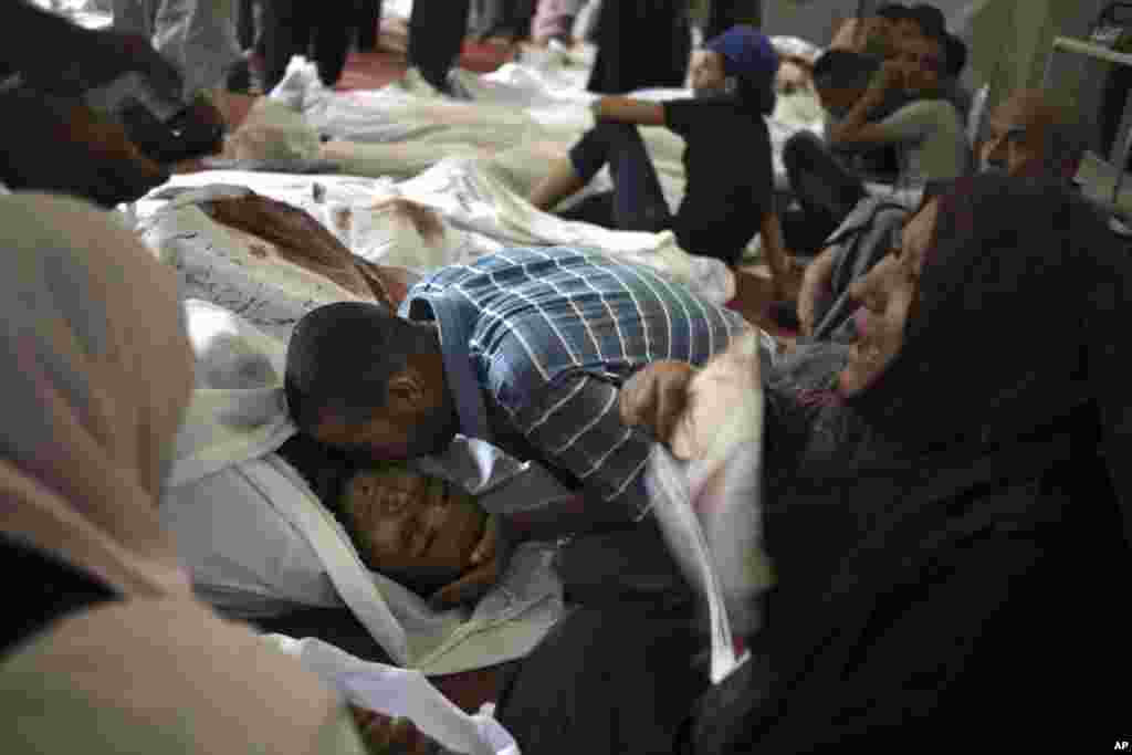 Egyptians mourn over the bodies of their relatives in the El-Iman mosque at Nasr City, Cairo, Augusts 15, 2013.
