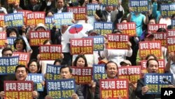지난해 6월 한국 서울의 시민단체가 탈북자 강제북송 반대 집회를 가졌다. (자료사진)