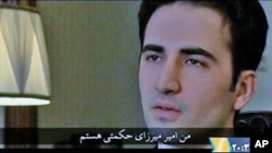 Iranian-American Amir Mirza Hekmati, who has been sentenced to death by Iran's Revolutionary Court on the charge of spying for the CIA, speaks in this undated still image taken from video in an undisclosed location in Iran, January 9, 2012.