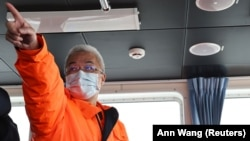 Commander Lin Chie-ming aboard his coast guard vessel in late January.