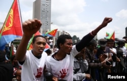 FILE - Eritrean refugees chant slogans as they participate in a demonstration in support of a U.N. human rights report accusing Eritrean leaders of crimes against humanity in front of the Africa Union headquarters in Ethiopia's capital Addis Ababa, June 2016.