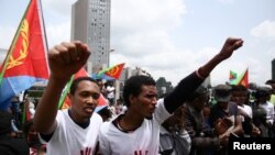 FILE - Eritrean refugees chant slogans as they participate in a demonstration in support of a U.N. human rights report accusing Eritrean leaders of crimes against humanity in front of the Africa Union headquarters in Ethiopia's capital, June 23, 2016.
