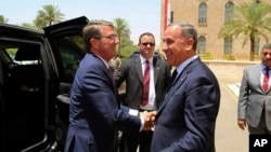 Visiting U.S. Defense Secretary Ash Carter, left, shakes hands with Iraqi Defense Minister Khaled al-Obeidi at the Ministry of Defense, Baghdad, Iraq, July 11, 2016.