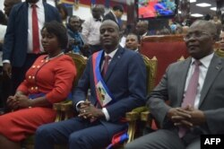 New Haitian President Jovenel Moise sits after receiving his sash, during his Inauguration, at the Haitian Parliament in Port-au-Prince, on Feb. 7, 2017.