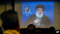 Hezbollah leader Sheik Hassan Nasrallah speaks via a video link, in Beirut, Lebanon, Oct. 12, 2018.