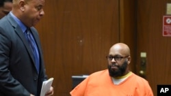 "FILE - Marion ""Suge"" Knight, right, appears with his attorney Matthew Fletcher, left, in court for a hearing about evidence in his murder case in Los Angeles, Calif., March 9, 2015."