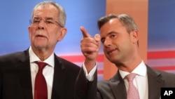 Norbert Hofer, à droite, le candidat d'extrême droite a été battu de justesse par Alexander Van der Bellen, à gauche, candidat aux élections présidentielles et ancien chef des Verts autrichiens, Vienne, 24 avril 2016